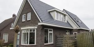 Complete dakrenovatie en uitbouw van woning